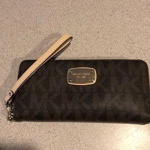 Michael Kors wristlet wallet in brown monogram